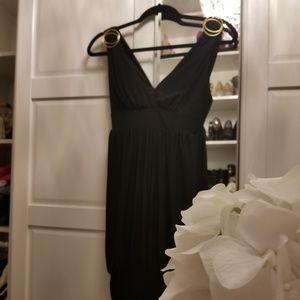 Black mini dress with gold detail